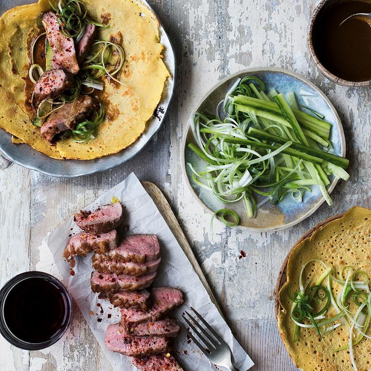 Quick, easy and bursting with Chinese flavour, make Melissa Hemsley's Hoisin Duck Pancakes from her cookbook, Eat Happy. Trade in your favourite Chinese takeaway dish for a healthy homemade version. Cut the succulent duck breasts into thin slices, sprinkle in chilli and place on a serving plate with hoisin sauce spiked with tahini and orange. Layout the duck, pancakes, cucumber and spring onions on the table and let your dinner guests help themselves to this vibrant fakeaway. #chinesefood