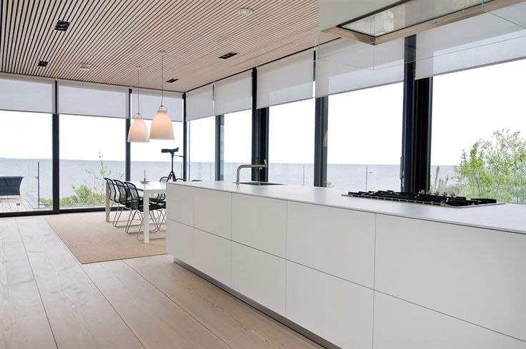 White Kitchen Enchanting Villa in Sweden Displaying an Interesting Blend of Simple and Rigorous Volumes