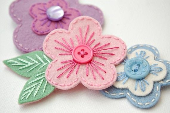 Three sweet pink, purple, and blue hair clips are made of 100% merino wool felt- The highest quality available. A mix of new and vintage buttons