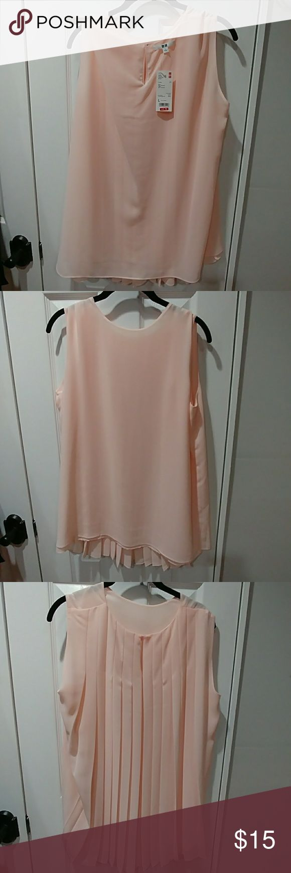 Uniqlo flowy shirt Soft pink shirt with pleated back. Hits a little below the waist in front and part of hips in the back Uniqlo Tops Blouses