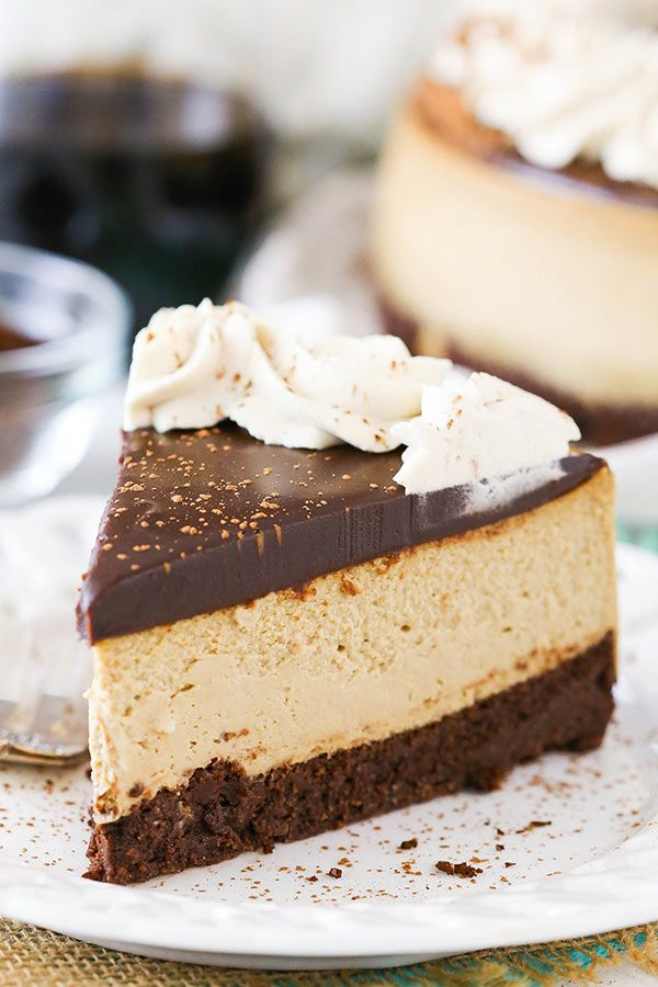 Kahlua Coffee Brownie Cheesecake - a dense brownie bottom, kahlua coffee cheesecake, kahlua chocolate ganache and kahlua whipped cream!