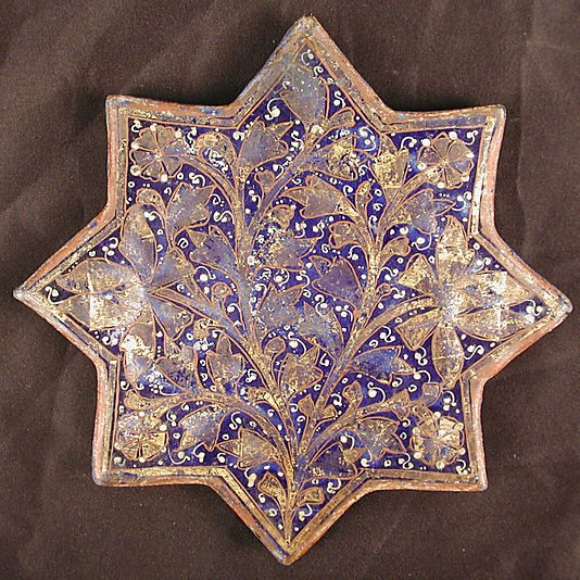 Star-Shaped Tile  Object Name:Star-shaped tile  Date:second half 13th–14th century  Geography:Iran  Culture:Islamic  Medium:Stonepaste; molded, overglaze painted and leaf gilded (lajvardina)  Dimensions:Diam. 7 7/8 in. (20 cm) D. 11/16 in. (1.7 cm)  Classification:Ceramics-Tiles  Credit Line:H.O. Havemeyer Collection, Gift of Horace Havemeyer, 1940  Accession Number:40.181.16