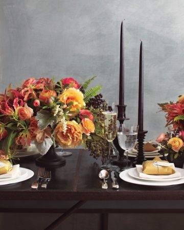 Autumnal BloomsChoose unexpected varieties of flowers that are readily available, add berries, then set them all against a dramatic backdrop of jet-black, which helps softer hues come alive. Here, compotes and towering tapers highlight blushing clusters of peonies and amaryllis, along with gloriosa lilies and andromeda. @Martha Stewart Weddings Magazine