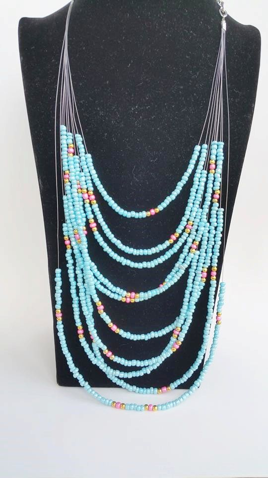 Check out this item in my Etsy shop https://www.etsy.com/pt/listing/234115869/boho-dainty-beaded-layering-necklace