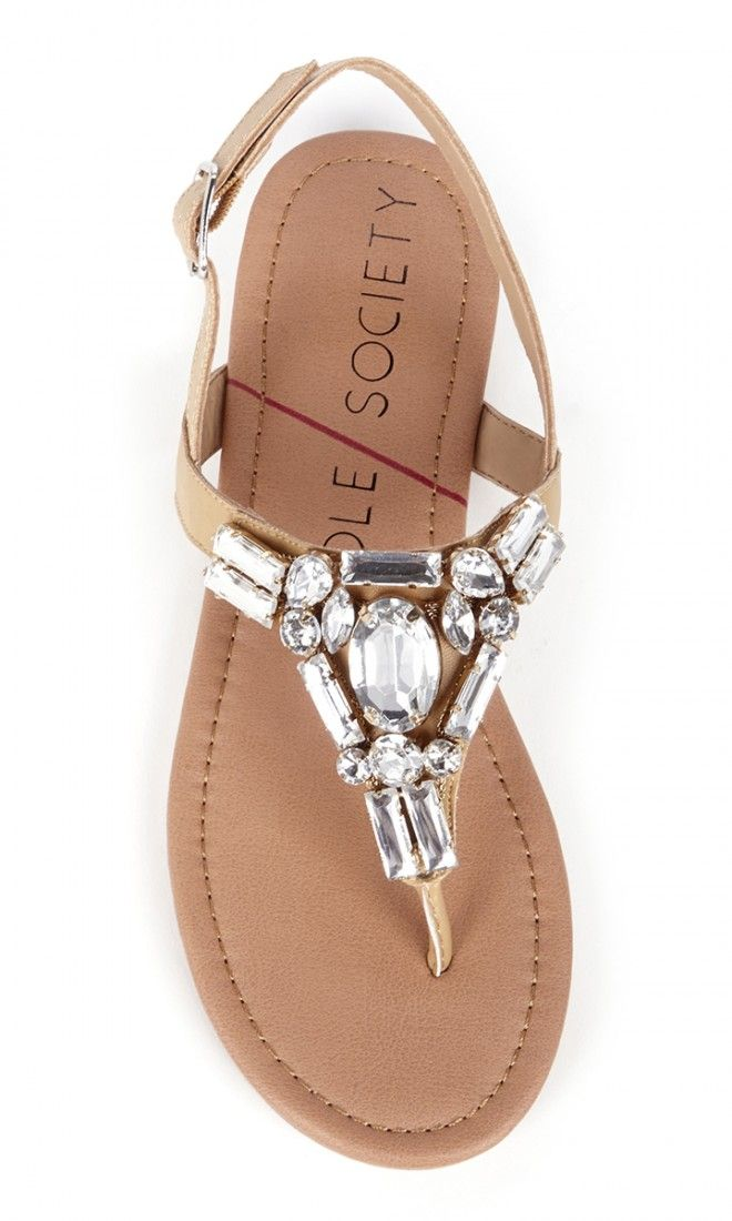 Neutral flat sandals bejeweled in sparkling crystal stones along the t-straps. Perfect for spring & summer.