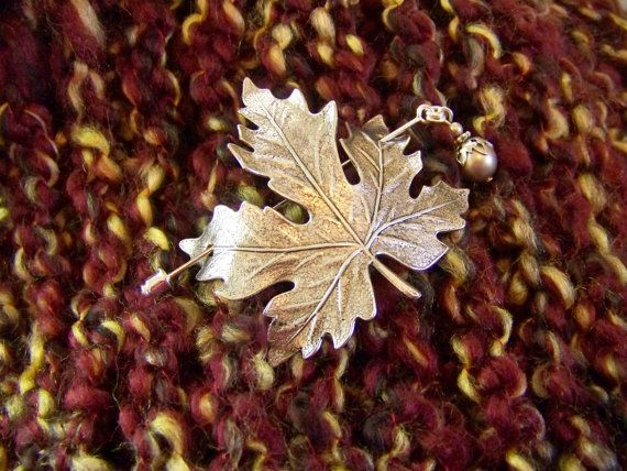 ♥´¨) ¸.•´ ¸.•*´¨)¸.•*¨) (¸.•´ (¸.•`♥~ A silver maple leaf is curved to accommodate your heavy sweater, shawl or scarf with a stick pin fastener. The silver plated brass stamped maple leaf is 50x55mm (2 x 2 1/8) . The leaf is antiqued to show the veining on the leaf. A beautiful accent for any shawl.  The 2 1/2 stick pin has a bead capped Swarovski platinum pearl dangle on one end and a silver clutch fastener on the other. The pin is sharp and can go through most materials. This...