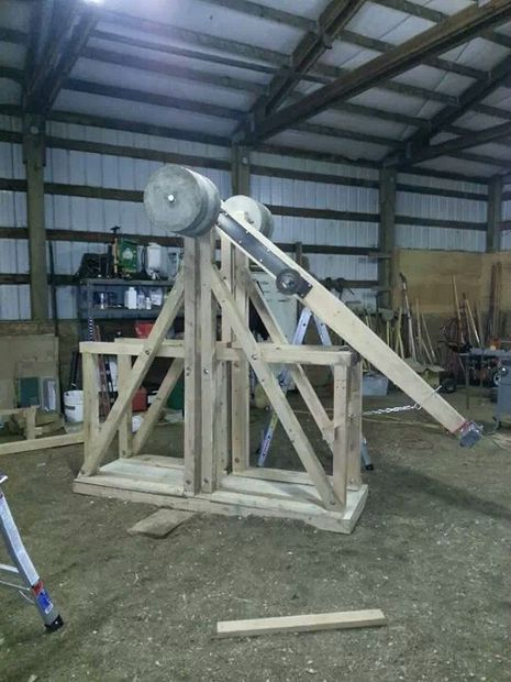 Floating Arm Trebuchet that could use an old weight set to drive it.