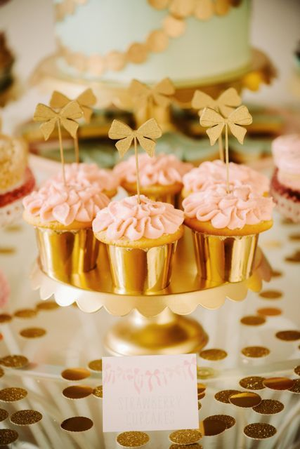 bridal shower goodies: cupcakes with ruffle frosting, bow toppers and gold cupcake holders! | Sweet + Saucy Shop