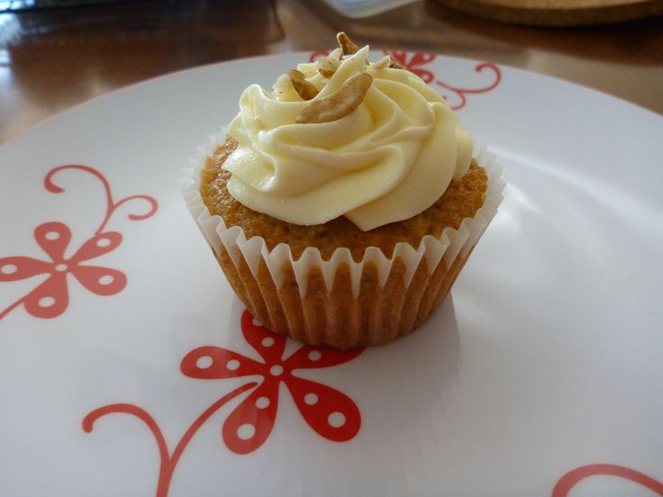 CARROT CUPCAKES.  1½ cups plain flour 1 cup sugar 1 teaspoon baking powder 1 teaspoon cinnamon 1 teaspoon bicarbonate of soda ½ teaspoon salt ⅔ cup vegetable oil 2 eggs 1 cup grated carrot 1 teaspoon vanilla essence ½ cup crushed pineapple, including juice 1/2 Cup Walnuts, crushed  METHOD- Mix all the ingredients for the cake in one bowl stirring slowly and then beat on medium speed for 2 minutes.  Bake at 180°C.  Make Cream Cheese Icing.