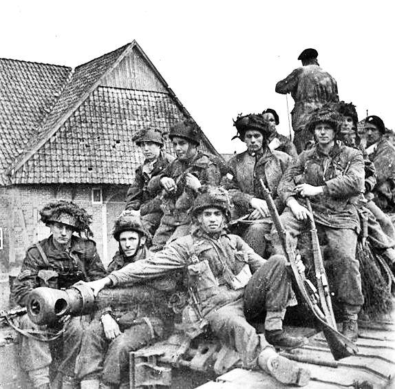 Canadian riflemen get a ride on unidentified tank destroyer, Netherlands, Oct 1944.