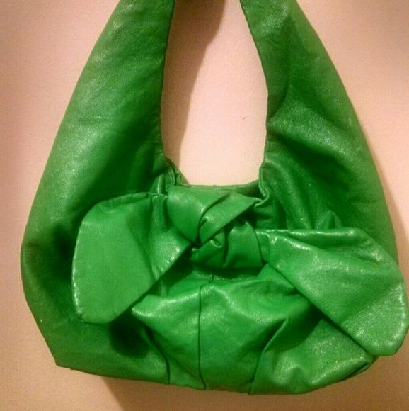 Green vinyl bow purse***Item-of-the-Week*** This bow purse will definitely make a statement!! Its cute and chic! It had a metal magnetic clasp and is lined with silky pink fabric. The bright color is cheery and pretty! Its in good condition. The lining inside does have some small stains(third picture). Still has lots of wear left in it and is waiting to be paired with your cute outfits!! This is the item of the week!! Read in the comments to know what that means! piper and blue  Bags Mini…