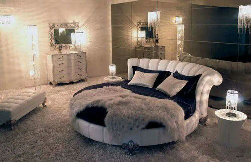 Tufted round bed. Plush bedroom.