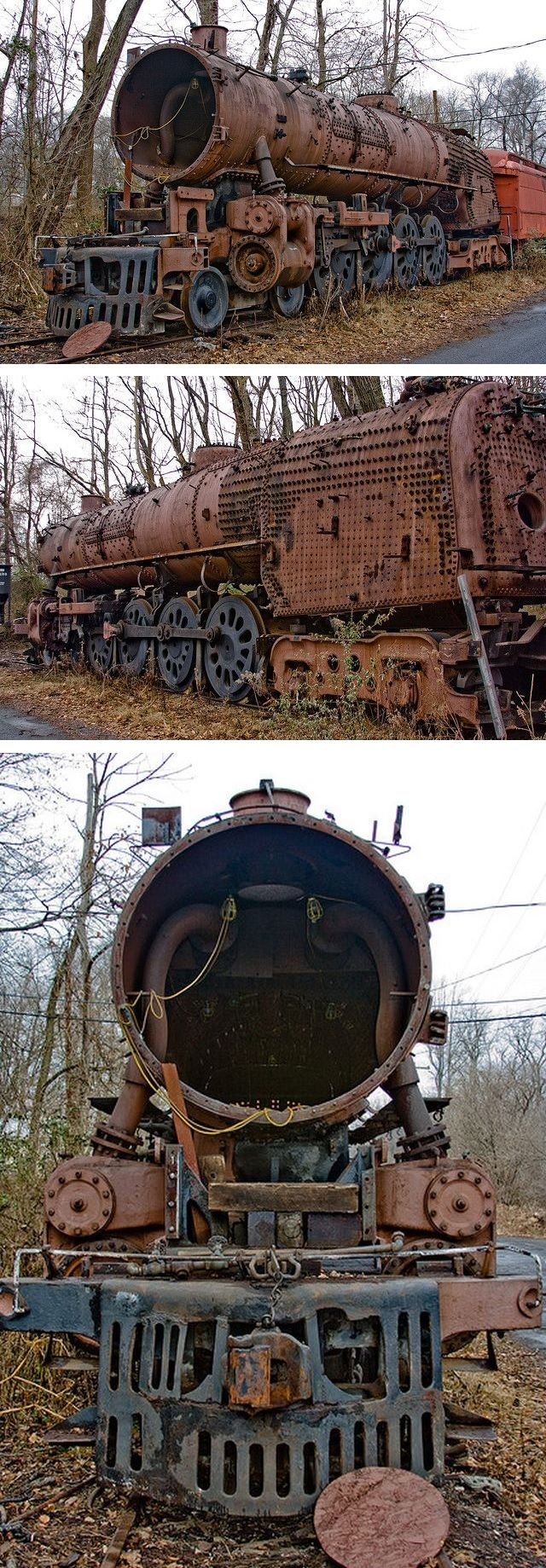Rusting abandoned locomotives left to rot for years in a derelict railway siding.
