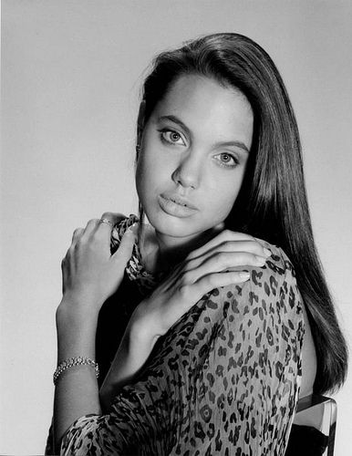 Angelina Jolie modeling at 18 years old.