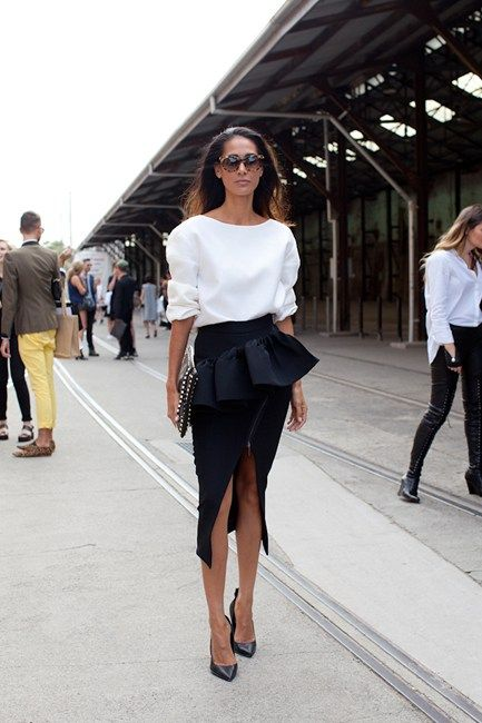 Street style at MBFWA 2014 in Sydney - Lindy Klim wearing a white Toni Maticevski top and black peplum skirt with Valentino clutch