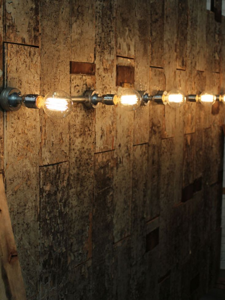 Bare Edison bulbs straight from galvanised trunking.