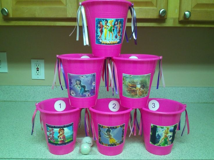 Easy kids party game. Toss beanbags/balls into buckets for stickers.