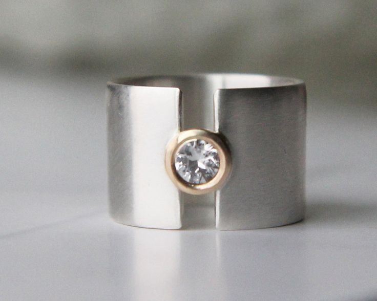 "engagement ring - weddding band - modern white sapphire sterling silver and gold - wide band ""lunar eclipse"" handmade by lolide. $228.00, via Etsy."