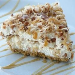 Coconut Caramel Drizzle Pie With Graham Cracker Crust, Butter, Shredded Coconut, Chopped Pecans, Sweetened Condensed Milk, Cream Cheese, Frozen Whipped Topping, Caramel Ice Cream Topping