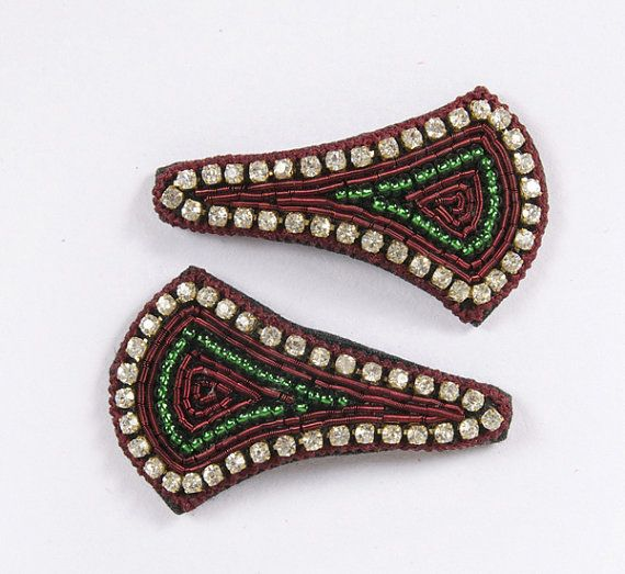 """A beautiful pair of hand embroidered broad triangular, almost kite shaped snap clips-""""tick tock clips"""". Maroon thread edging with diamonds and green beading embroidery in the center. Snap clip, diamantes, hand embroidered. Maroon, Green, Beading & Diamantes Broad triangle, almost kite shaped; Approx. 1 inches length by 1 1/2 inch width.  £8.00 on Etsy... Please click on the Etsy link to purchase."""