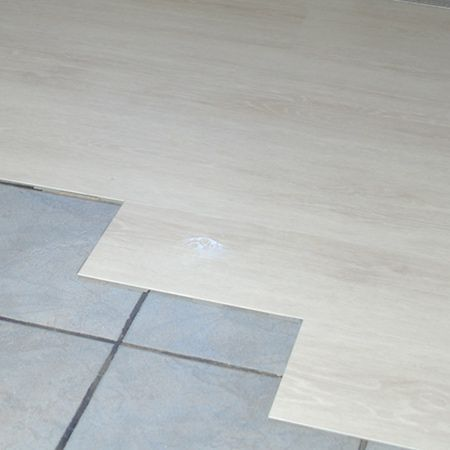 I recently posted a feature on covering up ugly tiles with