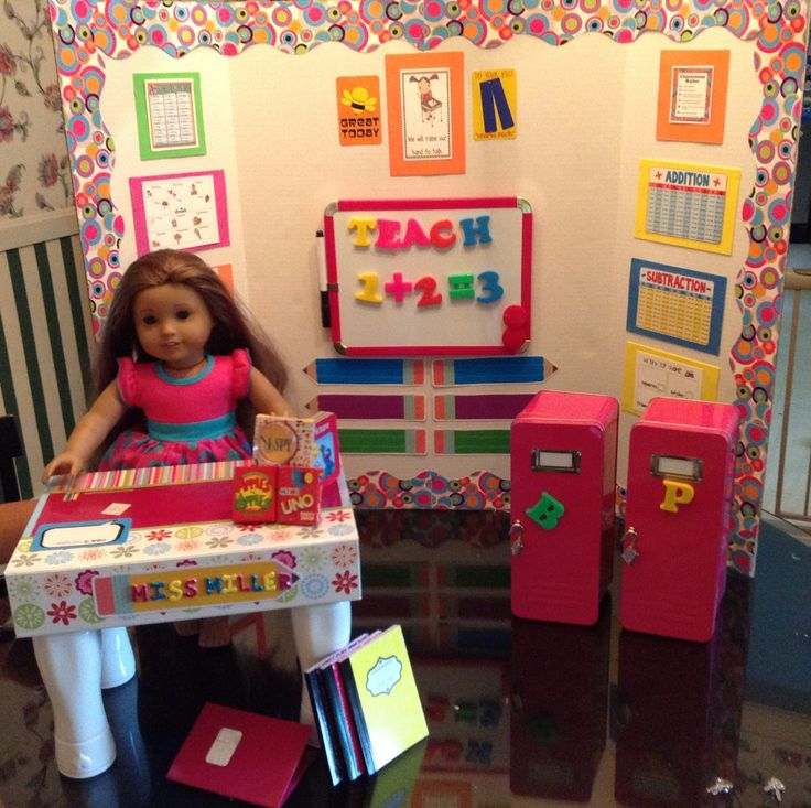 finished AG size doll school. Lockers are from CVS. Trifold, dry erase board, magnets, paper pencils and boarder are from Walmart. School related printables from other posts on pintrest. mini games from Family Dollar.  I used precut foam rectangles from Dollar Tree to tape the print outs on.  Kinda plain wihout the little pop of color.  This doll is Kanani from AG.  Dress is a dolly and me set from Kmart.