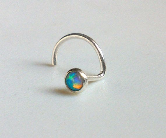 Hey, I found this really awesome Etsy listing at http://www.etsy.com/listing/115626371/tiny-opal-nose-stud-2mm-nose-screw