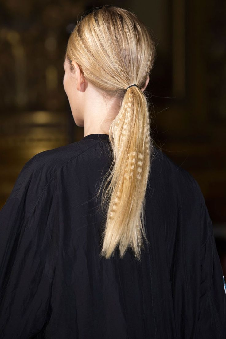 Hair Trends for 2015.Long Ponytails. Partly crimped hair in a ponytail.