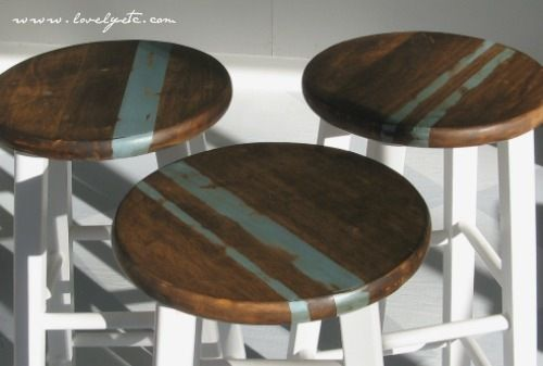 A painted strip of #color and a dark walnut #stain are used before distressing these one-of-a-kind #stools.  A solid stain can help you achieve a similar look that's uniquely yours.