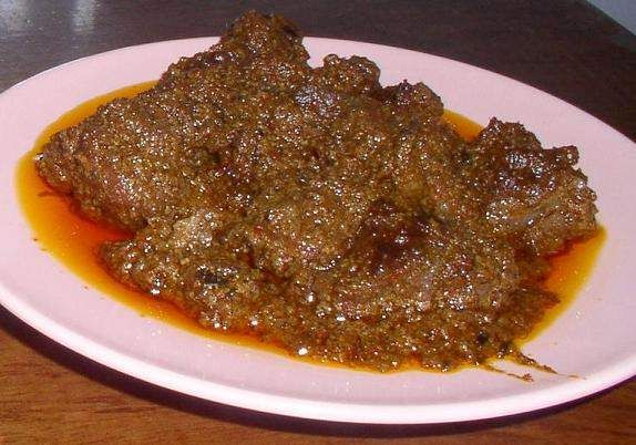 Rendang Padang: beef cooked with spicy seasoning and thick coconut meat. Originally from West Sumatra, Indonesia.