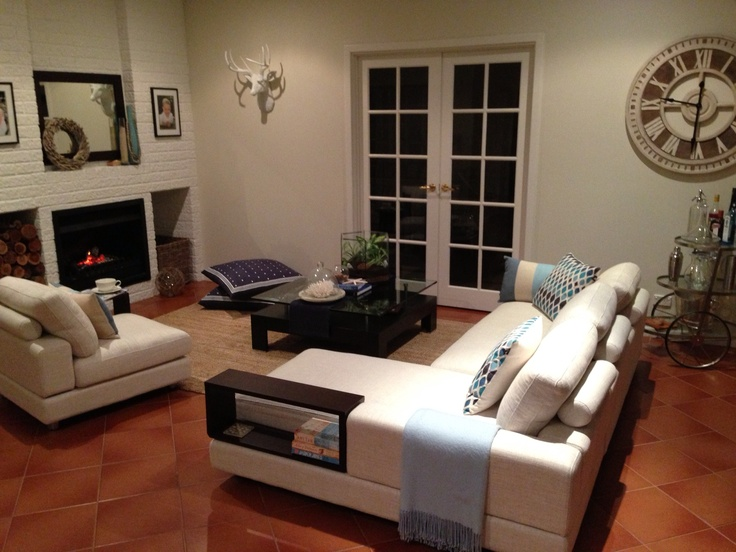 Baby Jasper King Furniture, white brick fireplace, large clock, wenge and white, french doors, drink trolley, stag head, large country road floor cushions
