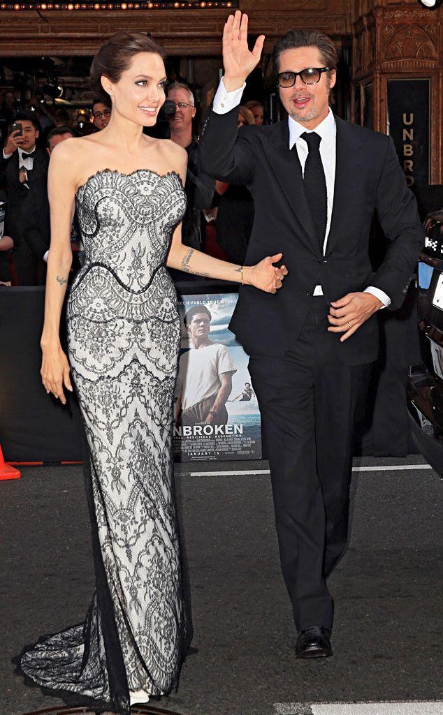 Power couple alert! Angelina Jolie and Brad Pitt greet fans at her Unbroken premiere.