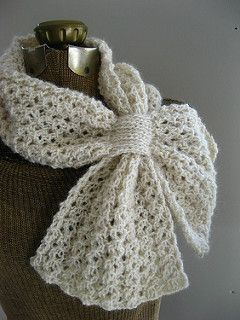 This light and lofty reversible lace honeycomb rib scarf features a loop to keep it in place and keep you warm!