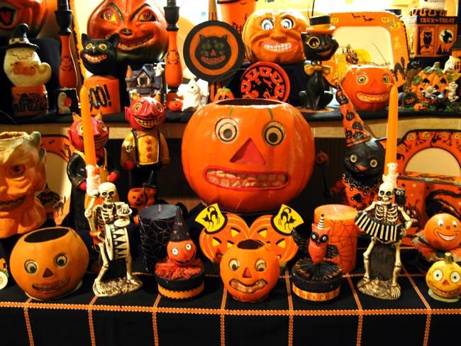 a collection of antique halloween decorations