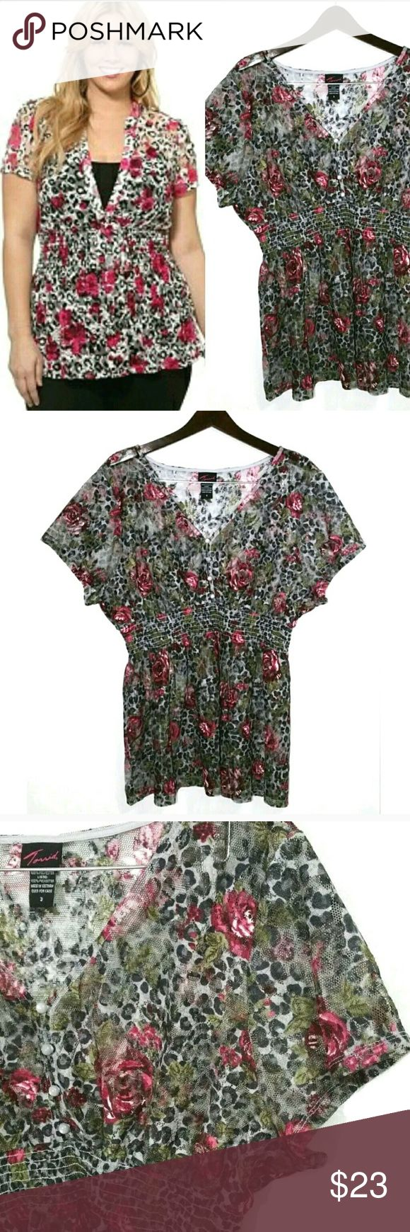 Torrid Floral Animal Print Lace Peplum 3 / 3X Torrid Floral Animal Print Lace Peplum  3 / 3X  Multicolor  Sheer lace with button up neck Smocked elastic waist  No flaws or defects refer to pictures  Measurements included in the pictures torrid Tops Blouses