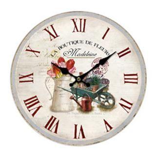 Nástěnné hodiny s květinami a vozíkem