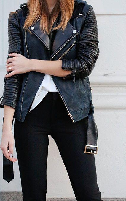 Black biker jacket, white shirt, and black skinny pants.