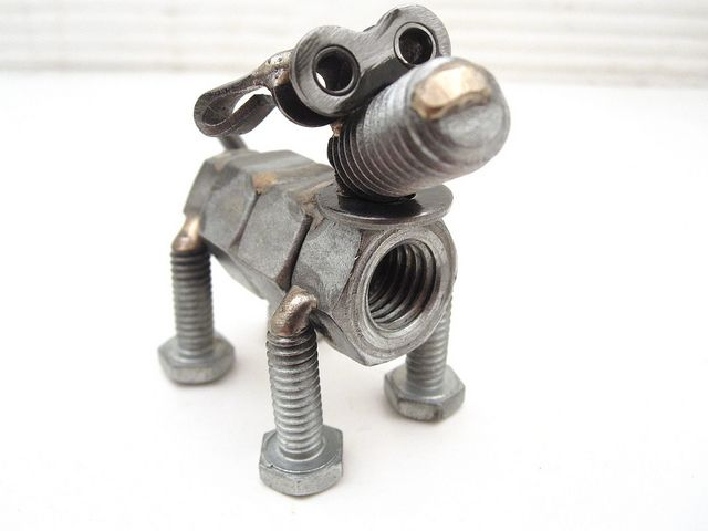Se questa non è arte non non sapremmo come definirla! :) #ferramenta - welded nuts and bolts dog sculptures