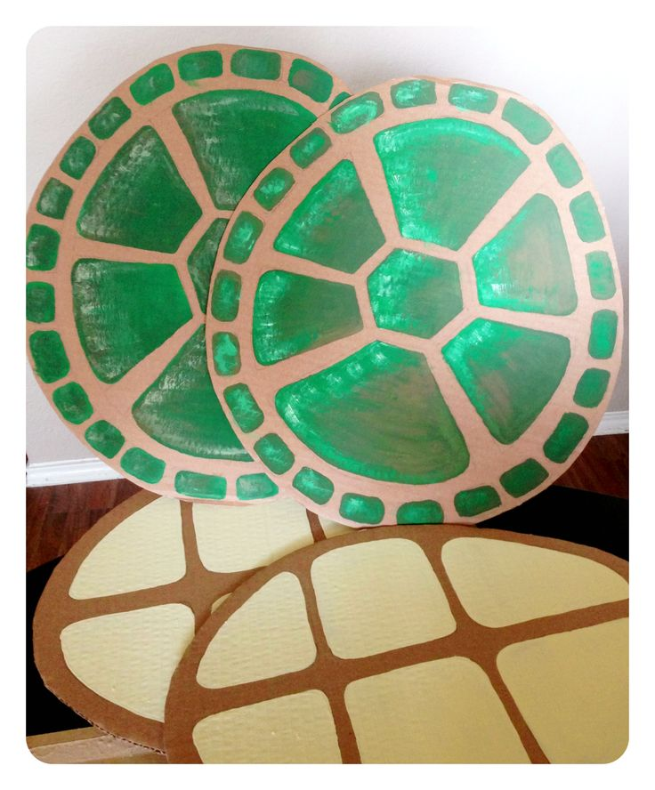 Cardboard Turtle Shells - One of the many DIY costumes we created for this year's One Act Play.  The breastplate and shell were attached with two strips of green felt and we added ribbon ties to sides to keep them in place.
