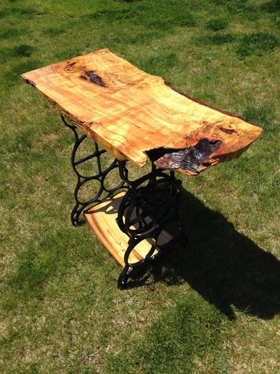 Rough cut table with antique sewing machine base  Etsy listing at https://www.etsy.com/listing/188857179/sassafras-sewing-machine-table