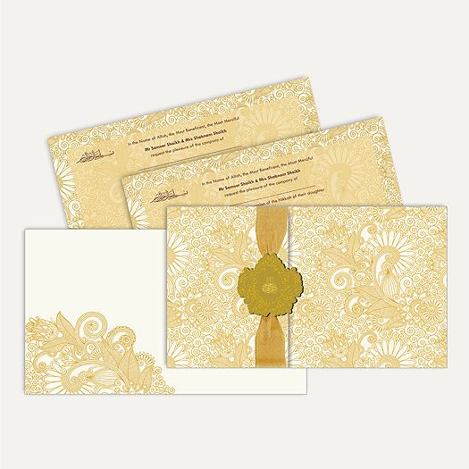 This card is made out of ivory paper board with matching mailing envelope. Card front has golden paisley design all around, gold ribbon is overlapped with laser cut 3d paste up having gold plated Bismillah on it. #IslamicWeddingCard #wedding