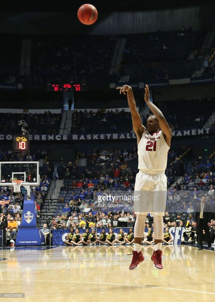 Arkansas Razorbacks guard Manuale Watkins (21) scores a three point basket during the first half of the second semi final game in the Southeastern Conference Basketball Tournament between Vanderbilt and Arkansas on March 11, 2017, at Bridgestone Arena in Nashville, TN. Arkansas will play Kentucky in the Southeastern Conference Championship after Vanderbilt 76-62.