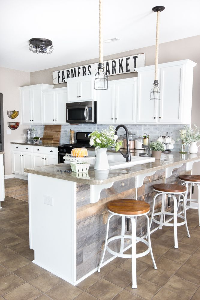 A dark and boring builder grade kitchen gets a budget-friendly makeover with modern farmhouse style using 100% doable DIY projects.