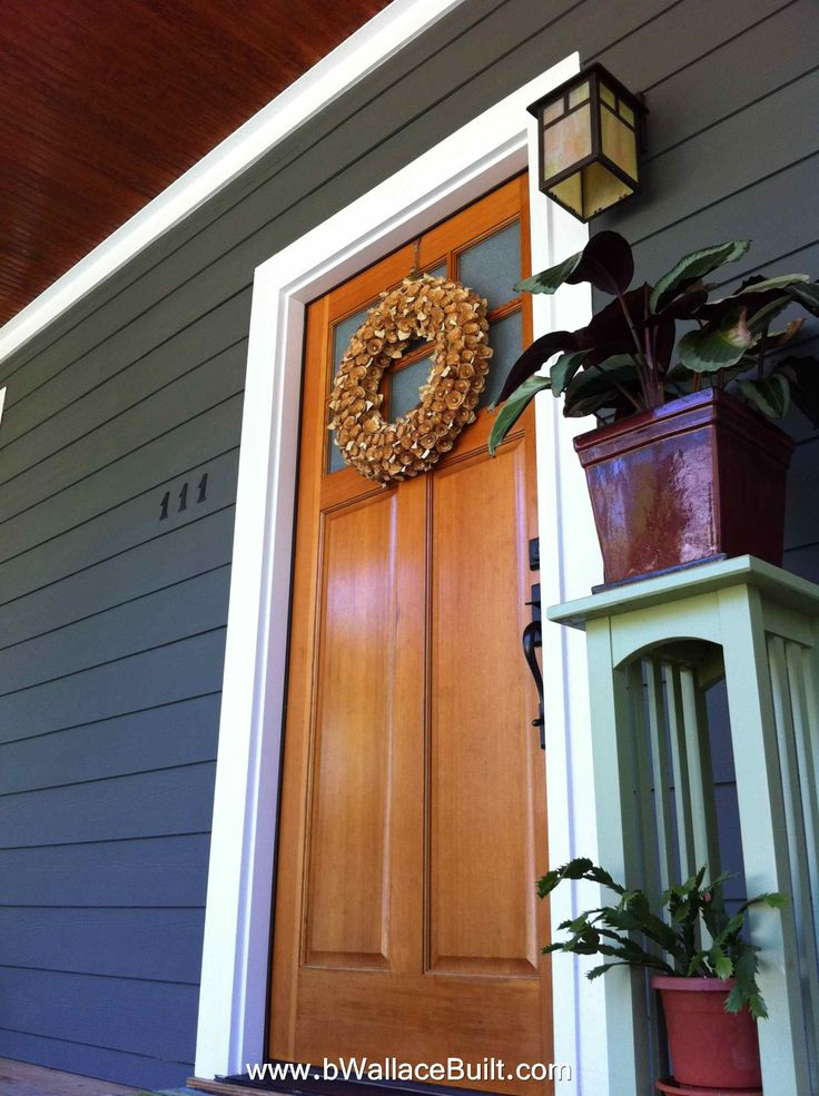 natural wood front door looks great with any house color