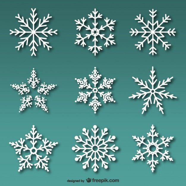 Conjunto de copos de nieve blancos. Vector gratis.