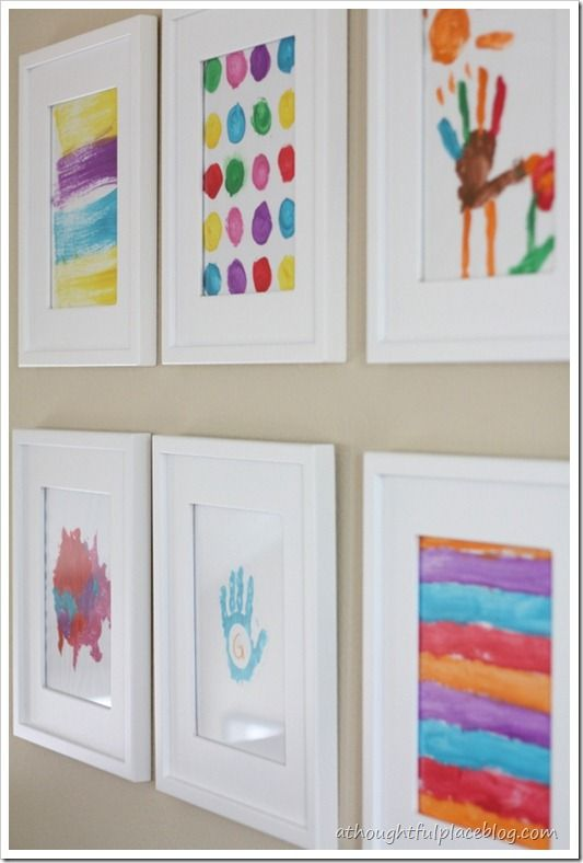 love this idea of using kids drawings and paintings as art on your gallery wall - Kids Room Wall Decor Ideas
