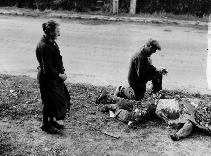 So sweet. French townspeople lay flowers on the body of an American soldier #DDay