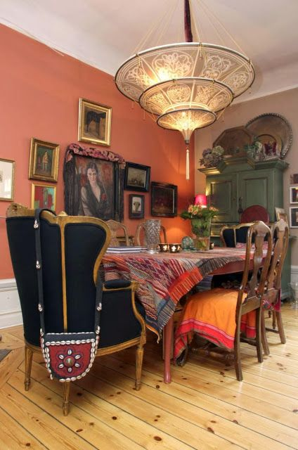 Feeling this bohemian dining room, from the color on the wall, to the mixed chairs, to the light pendant to the colorful textiles.