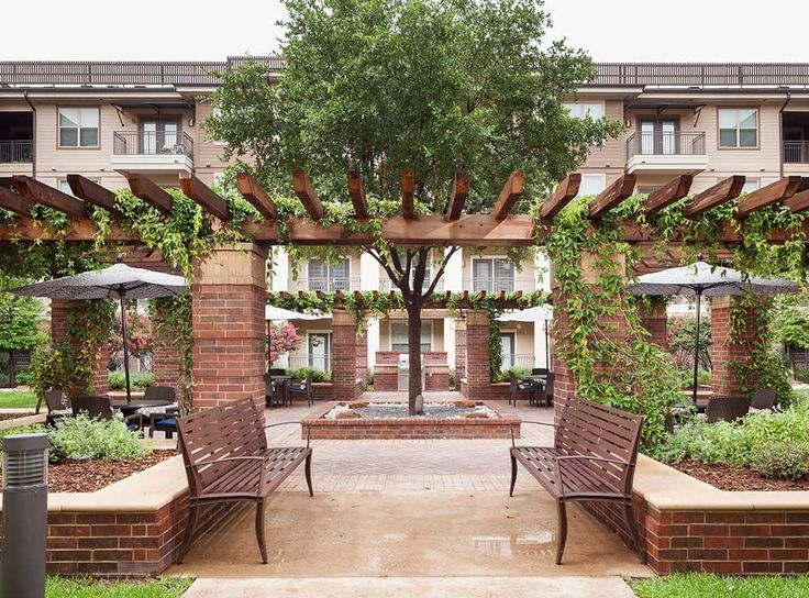Beautifully landscaped relaxation courtyards with grills and outdoor cooking area at AMLI on Maple, luxury apartments in Uptown Dallas