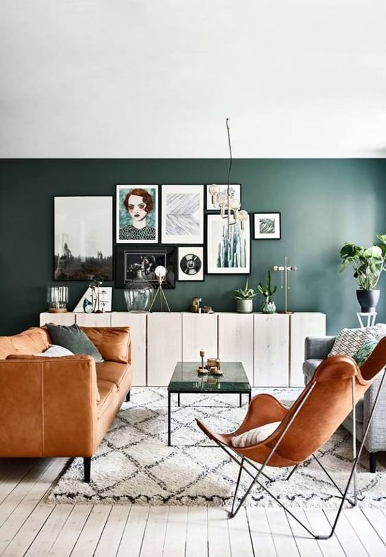Butterfly cognac Chair, green walls, cognac couch